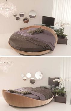 lovely wooden round bed. with down comforters, it'd be like your own nest!