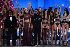 Adriana Lima Photos Photos - US singer Bruno Mars (2ndL), US singer Lady Gaga (C) and Canadian singer/songwriter The Abel Tesfaye a.k.a The Weeknd (L) cheer alongside Victoria's Secret Angels Brazilian model Adriana Lima, Swedish model Elsa Hosk, Brazilian model Alessandra Ambrosio, US model Taylor Hill, US model Martha Hunt, Portuguese model Sara Sampaio, Brazilian model Lais Ribeiro, US model Gigi Hadid and US model Kendall Jenner during the 2016 Victoria's Secret Fashion Show at the…
