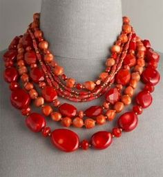 Coral beaded necklace - the color is perfect. The tonal qualities of the beads make it interesting.