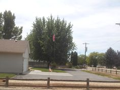 PT  80 JULY 2014 FLAGS ON VICTORY ROAD RURAL IDAHO.