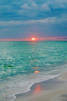 Meet me where the sun kisses the sea goodnight