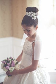 Precious first communion headpiece and veil...her little top knot is so cute!