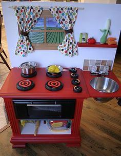 play kitchen made of an old night table, goodwill finds and mod podge!!!