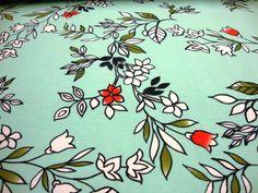 Baumwolljersey Digitaldruck Blüte, Blumen, Blätter auf Türkis
