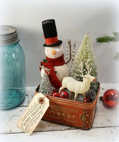 Antique Inspiration Collection 2014.... Embellished with Antique and Vintage Finds...    This Sweet Snowman is hand sculpted and decked out in