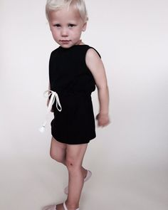 soft and lightweight with drawstring waist and keyhole button back. black with white tassels. 100% organic cotton jersey.