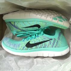 Nike Free 4.0 Flyknit Sneakers Woman's Nike free 4.0 Flyknit Sneakers in hyper turquoise, purple and volt yellow. Very close to Tiffany blue. Size 8.5. New with original box, minus lid. Cheaper through ♏️ - 1 day sale for $85 through there! Nike Shoes Sneakers