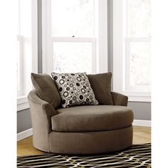 Roenik Oversized Swivel Accent Chair - Sam's Club. I need two of these to create my cozy sitting area.