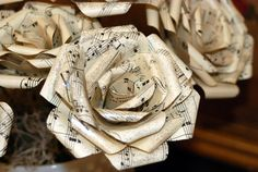 Paper flowers made from vintage sheet music -4 inch-. $4.00, via Etsy.