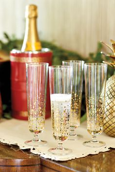 Bunny Williams' gold, bubbly champagne flutes are the perfect but of glamour for your holiday party!