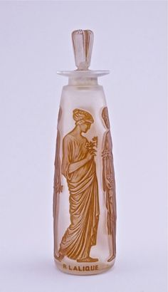 1921 R. Lalique, Coty Ambre Antique perfume bottle and stopper, clear/frost glass, sepia patina, molded label and R. Lalique.
