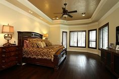 AN ELEGANT MASTER SUITE ENVELOPS YOU WITH WARMTH & COMFORT-FROM THE WIDE-PLANK TIGERS EYE WALNUT FLOORS TO THE HIGH TRAY CEILING WITH METALLIC FAUX TREATMENT, BRONZE FAN & IN-CEILING SPEAKERS. DARK STAINED PLANTATION SHUTTERS HAVE BEEN ADDED.