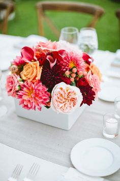 Crimson, Peach and Coral Centerpiece  - this color scheme could work to pull in something dark