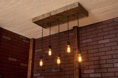 Industrial lighting Cage Light Chandelier por Bornagainwoodworks