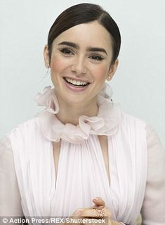 Face shaper: Lily pulled a number of faces during the photocall...