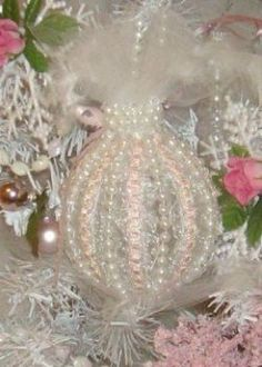 Tulle, beads, pearl string and ribbon.