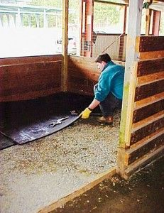 Prepping stalls and installing mats