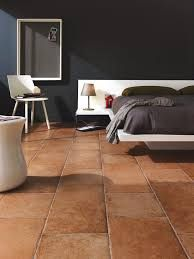 PIN Terracotta floor tiles used in a contemporary bedroom. The tiles make this room look a little industrial but also very natural and earthy. Tile Bedroom, Bedroom Flooring, Tile Flooring, Teracotta Floor, Grey Feature Wall, Feature Walls, Mercure Hotel, Oak Bedroom Furniture, Terracota