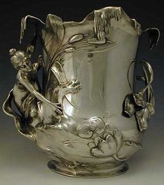 WMF PEWTER CHAMPAGNE BUCKET WITH MAIDEN Manufacturer WMF Designer Description Polished Pewter Champagne Bucket Country of Manufacture Germany Date Circa 1906 Marks Marked to base Condition Perfect