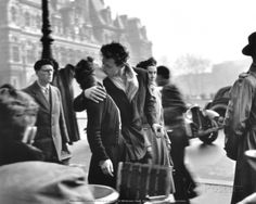 """Taken in front of a Parisian café in Robert Doisneau's most famous photograph, """"Le Baiser de l'Hotel de Ville"""" (above) became a symbol of Paris as the """"city of love"""" and one of the iconic photographs of the century. The much-loved photographer Robert Doisneau, French Photographers, Street Photographers, Vintage Photography, Couple Photography, Famous Photography, Urban Photography, Color Photography, Kevin Carter"""