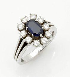 Ring mit Saphir und Brillanten750er WG, gestemp. Punze: A M. 10 Brillanten zus. ca. 0,80 ct. 1 Saphi