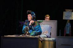 Tamino (Andrew Bidlack) hides from the bird catcher Papageno (Jonathan Michie). The Magic Flute.