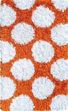 Orange and white poka-dot rug!