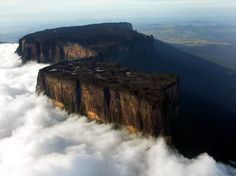 Mount Roraima is the highest in the chain of tepui plateaus in South America. Standing at a staggering ft tall, the wondrous peak serves as a triple border for Venezuela, Brazil and Guyana . Monte Roraima, Places Around The World, Around The Worlds, Zhangjiajie, The Lost World, Paraiba, So Little Time, Vacation Spots, South America