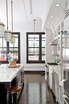 I'm a sucker for a white kitchen-- especially one with a contrasting dark floor.  The openness of the space and hanging lights are pretty great, too.