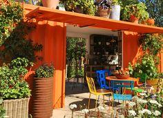 Colourful outdoor seating area | Chelsea flower show | Contemporary gardens | Oxford Garden Design