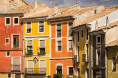 Colourful row by CarinaB01  sky city travel architecture roofs colours houses Spain CarinaB01