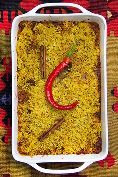 Indian Lamb Biryani: A casserole of tender lamb curry and saffron spiced rice with cooling cucumber-mint raita on the side. Company worthy! |Panning The Globe