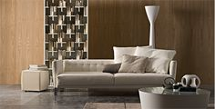 http://sandavy.com/pretty-convex-low-tables-moya-from-arketipo/arketipo-light-low-tables-in-modern-living-room-white-cream-sofa-four-cushion-with-white-colors-and-cream-marmer-floor-wooden-wall-white-carpet-furniture-in-the-arketipo-libary-books-in-rack-single-so/