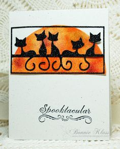 handmade Halloween card ... cute and sophisticated ... huge sponge orange half moon ... luv the die cut of cats on a line with tails like flourishes ... black & glittery ...