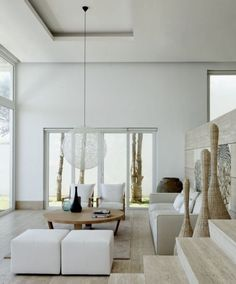 This living room incorporates the light open spaces with subdued colors my client is looking for. Picture by Archipelago Design Works http://www.homedsgn.com/2011/09/21/c-house-by-archipelago-design-works/batangas-house-02/