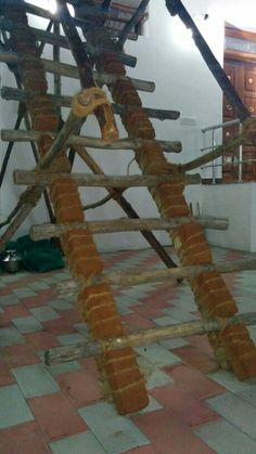 Creative idea.  Brick and wood blended ladder to support heavy lifting.