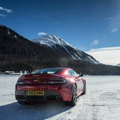 Burgundy Aston Martin Vantage on ice! this means only one thing... DRIFTING SESH!!!