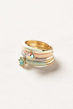 "Radiance Stacking Rings #anthropologie  Wish all 4 were just bands, no ""glass"" stones. Or even just the green stone and then 4 bands. Love the colors, otherwise."