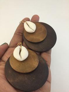 Wood and cowry shell earrings.