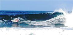 Friends surfing Playa Negra, Costa Rica
