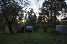 A dusk wide angle of the side of her property. The shed, clothes line, and upturned water tanks can be seen. Does not provide answers to the viewer of the series, and therefore is not needed within the final.