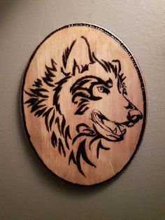 A tattoo-like smiling wolf pyrography. It is ready for wall hanging! It takes about 3 days to make and each one is handmade. 2 dimensions available : 18 X 14 cm 25 X 17 cm Burned wood and shellac. Due to the fact it is a handmade product, each pyrography is unique and there are some