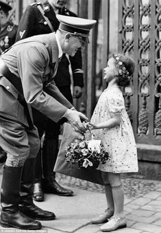 Nazi theme: Flower girls were used to boost Hitler's image as father of the nation - and f...