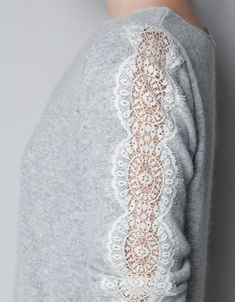 I love the lace on this sweater from a Russian site about stylish clothing alterations and interior.