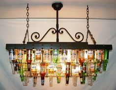 make a beer bottle chandelier - very crafty . mmmm, I dunno - I kind of like this idea for over my pool table. and maybe make another one out of champagne/wine bottles for the dining room. I (Champagne Bottle Chandelier) Beer Bottle Chandelier, Bottle Lamps, Bottle Candles, Bottle Lights, Game Room, Home Projects, Mosaic Projects, Crafty Projects, Home Improvement