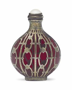 A RARE SILVER-ENCASED RUBY-RED GLASS SNUFF BOTTLE 1740-1820
