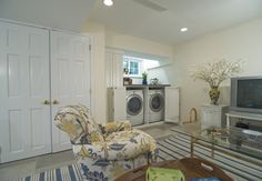 Beautiful white melamine laundry room, perfectly integrated into this den.   Designed by Deb Broockerd  #laundryroom #laundry   Learn more: https://www.closetfactory.com/laundry-room/