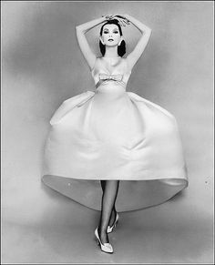 Dovima in beautiful deep yellow satin dress that's drawn high in front at the waist and again at the hem by Balenciaga, photo by Richard Avedon, Harper's Bazaar, November 1958