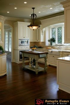 """English cottage kitchen- love the island and windows, not a fan of the """"grandeur"""""""