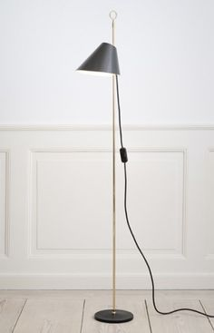 Azucena, Contemporary, Italy. Designed by Luigi Caccia Dominioni, 1953.   Floor lamp. Stem in polished brass and base in black painted cast iron. Sliding reflector in metallic grey aluminium. H124 cm